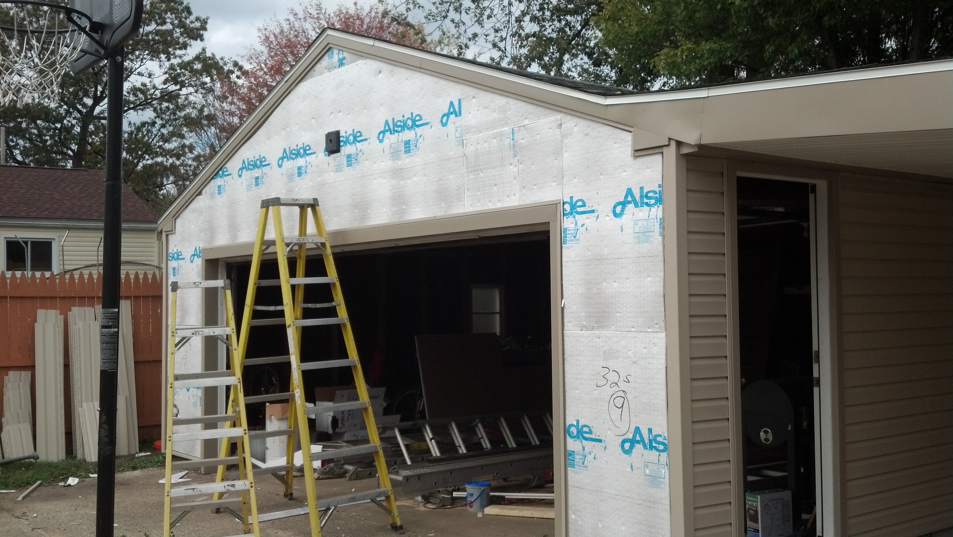 garage siding under repair